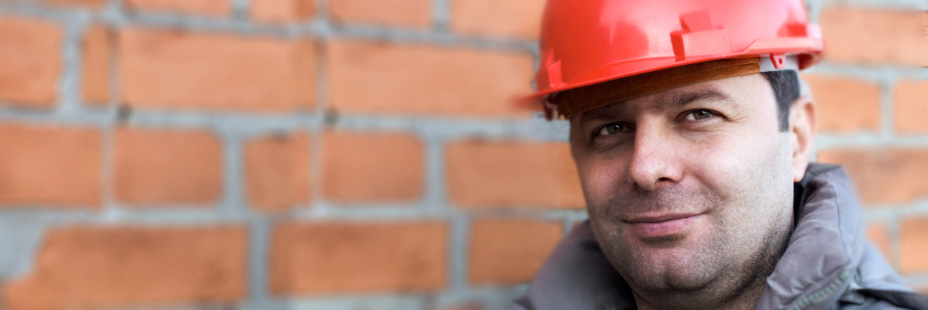 Smiling construction worker. Thriving in the workplace. www.graybridgemalkam.com
