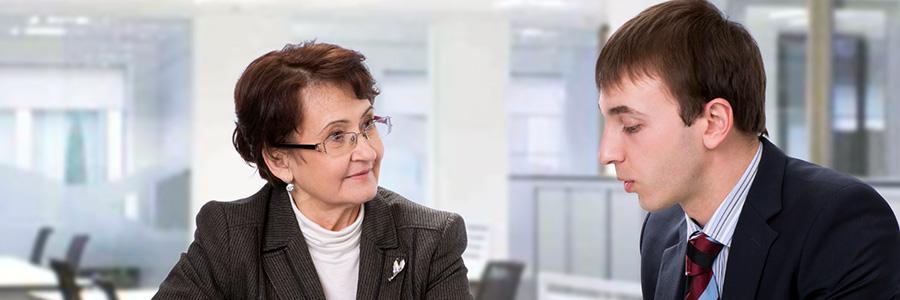 Woman coaching younger man. Diversity Mentoring Program. www.graybridgemalkam.com