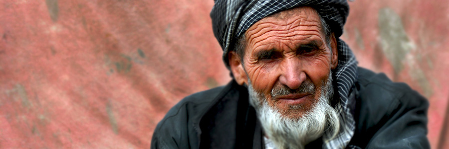 Afghan man looking at camera. Intercultural Training. www.graybridgemalkam.com